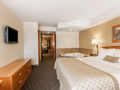large king bed with whirlpool in room