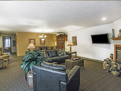 presidential suite with couches and fireplace